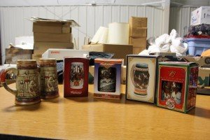 Budweiser Collectible Steins, Holiday, Anniversary and 1984 Olympic Editions for 25th and 75th Anheuser-Busch Mugs at Value Auction Barn Columbia MO Antiques Collectibles Estate Auctions Sale