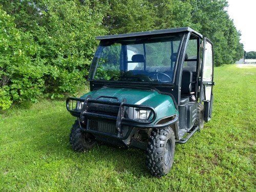 Green Polaris Ranger 2005 4x4 Four Wheel Drive UTV All Terrain Utility Vehicle for sale at Value Auction Barn in Columbia MO Farm and Hunting Equipment