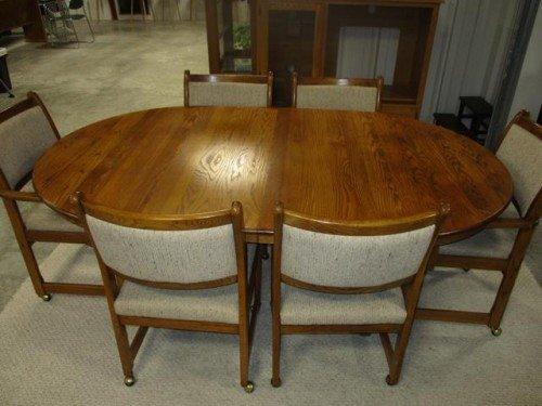 Solid Wood Oval Kitchen Table with Leaf and Six Padded Rolling Chairs with Armrests at Value Auction Barn Missouri Columbia 1608
