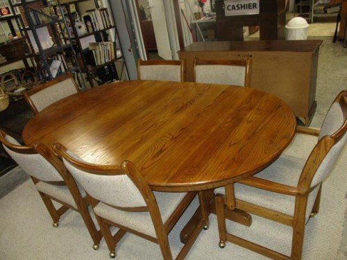 Solid Wood, Oval Kitchen Table with Leaf and Six Padded Rolling Chairs, two with Armrests at Value Auction Barn
